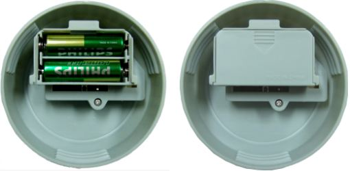 Automatic Coin Counter - bottom of lid showing battery compartment, containing two AA batteries
